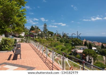 Top view of the Italian town Bordighera and the Mediterranean Sea - stock photo