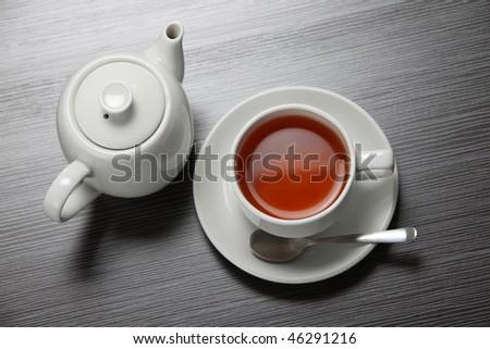 top view of the tea pot and tea cup - stock photo
