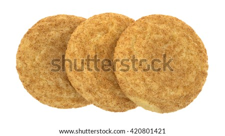 Top view of three baked snickerdoodle cookies isolated on a white background. - stock photo