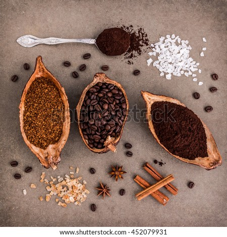 Top view of three different coffee beans and Instant Coffee add aromatic with cinnamon. on tile dark vintage background. - stock photo