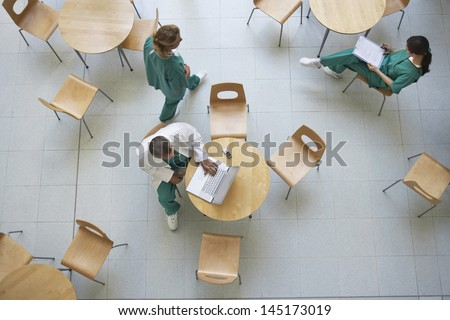 Top view of three physicians during work break in the cafeteria - stock photo