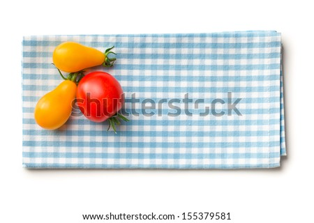 top view of tomatoes on checkered napkin - stock photo