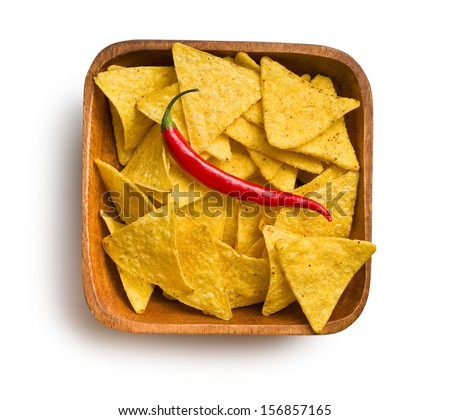 top view of tortilla chips with red chili pepper in wooden bowl on white background - stock photo