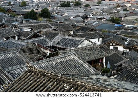 Top view of traditional roof at The Old Town of Lijiang is a UNESCO World Heritage Site located in Lijiang City, Yunnan, China.