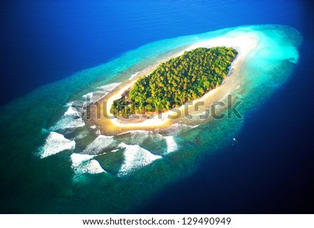 top view of tropical island in turquoise blue water. maldives panoramic landscape - stock photo