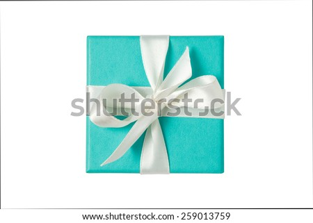 Top view of turquoise isolated gift box with white ribbon on white background - stock photo