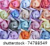 Top view of twenty colorful paper roses arranged as a decorative background - stock photo