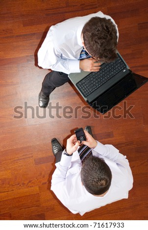 Top view of two  business men using laptop and phone mobile and having conversat - stock photo