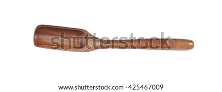 Top view of used wooden tea spoon isolated