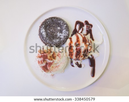 Top view of vanilla ice-cream and chocolate brownie - stock photo