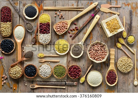 Top view of various leguminous with a cookware - stock photo