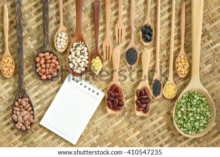 Top view of various leguminous with a wooden cookware, Flat lay - stock photo