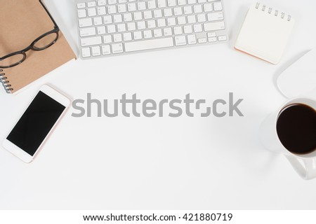 Top View of Various Office Supplies on white table with Ample Copy Space