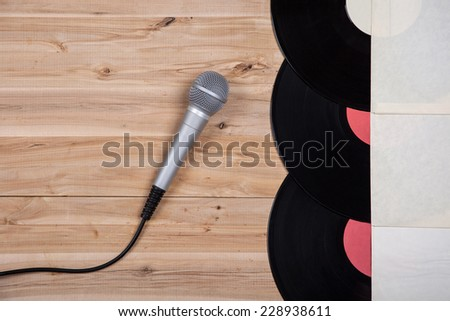 top view of vinyl record over wooden table and microphone - stock photo