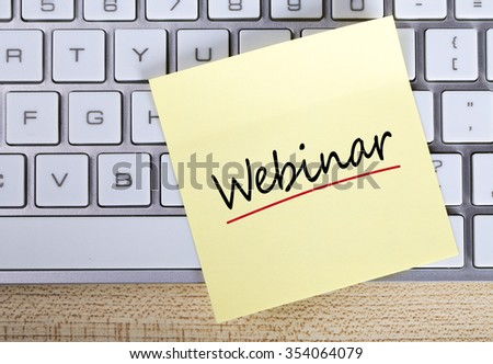 Top view of Webinar sticky note pasted on the keyboard. - stock photo