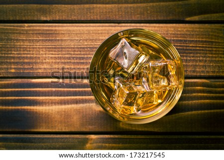 top view of whiskey in glass with ice - stock photo