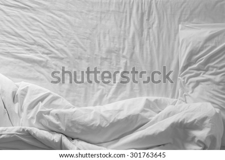 Top view of white bedding and pillow at morning time - stock photo
