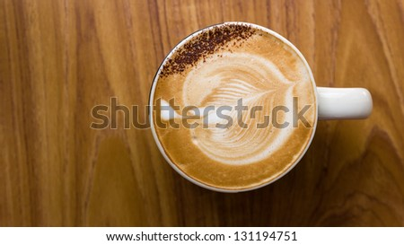 Top view of White ceramic cup of coffee on wood table - stock photo