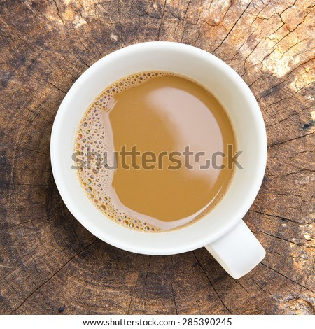 Top view of  white cup of coffee on wooden background - stock photo