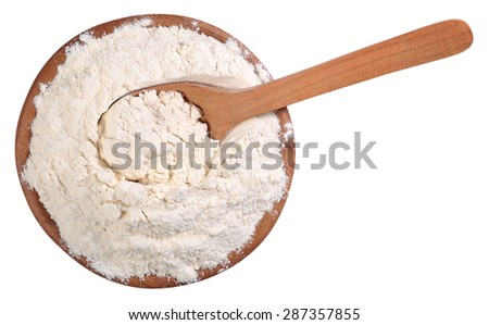 Top view of white flour in a wooden bowl with spoon on a white background  - stock photo