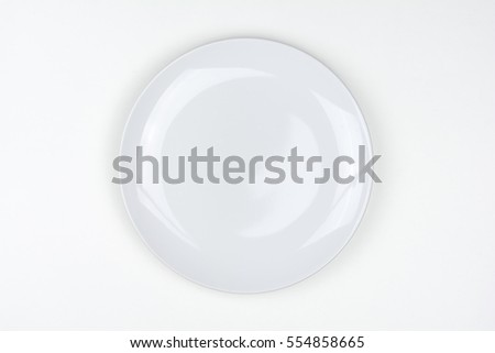 Top view of white plate on white background