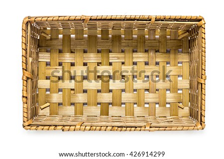 Top view of wicker basket isolated on white background - stock photo