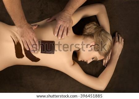Top view of woman having a hot chocolate massage. Studio image. - stock photo