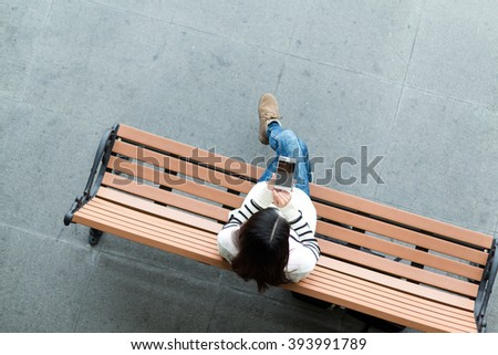 Top view of woman using cellphone - stock photo