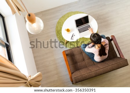 Top view of woman using computer for working at home - stock photo