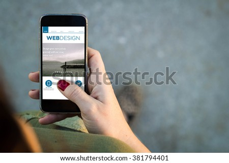 Top view of woman walking in the street using her mobile phone on a web design site with copy space. All screen graphics are made up. - stock photo