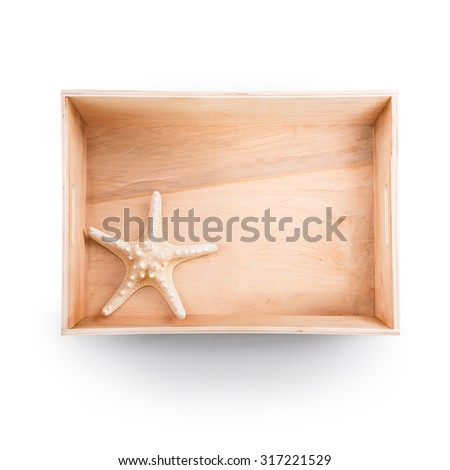 Top view of  wooden box. Starfish inside - stock photo