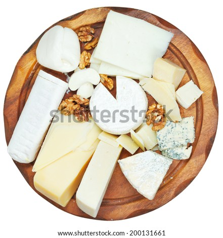 top view of wooden plate with various cheeses isolated on white background - stock photo