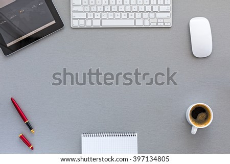 Top View of working Place on grey wooden Desk in classic tones with Computer Keyboard Coffee and other Business Items