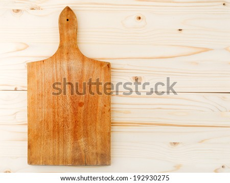 Top View of Worn butcher block cutting plate and chopping wooden board as background. Wood texture. - stock photo