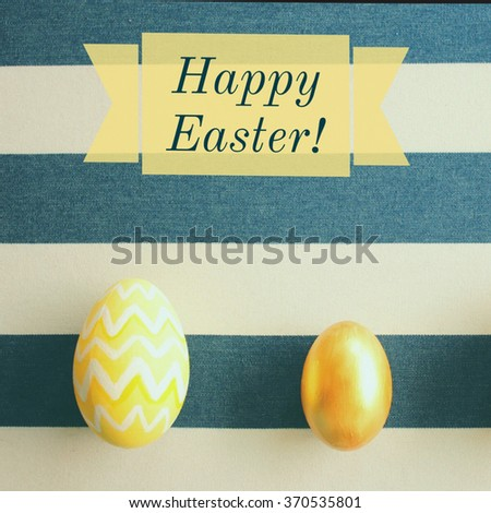 Top view of yellow easter eggs on striped background with happy easter word