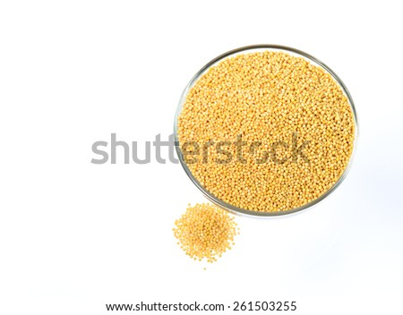 Top view of yellow mustard seeds in glass bowl with heap isolated on white background  - stock photo