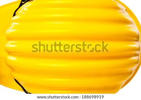 Top View of Yellow Safety Helmet Hat with SAFETY FIRST word tag isolated on white background. - stock photo