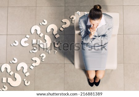 Top view of young businesswoman sitting on chair - stock photo