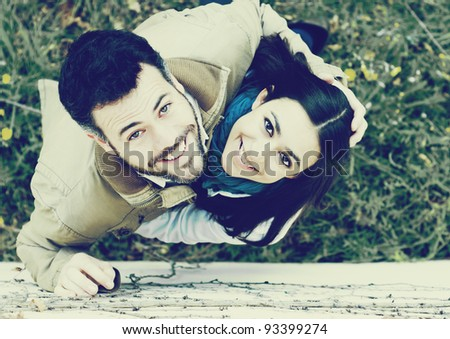 Top view of young smiling couple - stock photo