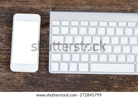 Top view office workplace -   keyboard and phone on wooden background, copy space on screen  - stock photo