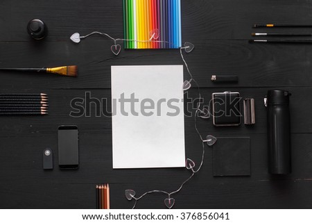 Top view office workplace. Wallpaper, advertising, post on social networks and blog. View from above with copy space. On table lay stationery items, paints, pencils and easy for creative work artist. - stock photo