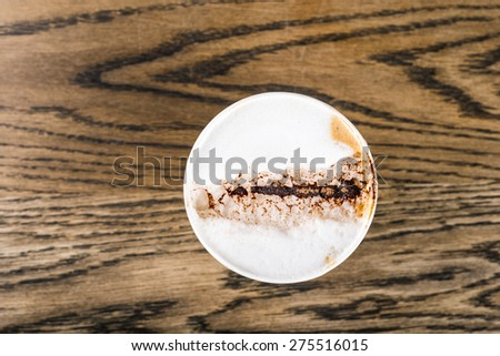Top view old cappuccino on rustic wooden table - stock photo