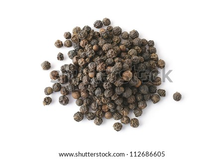 Top view on a pile of black whole pepper isolated on white background - stock photo