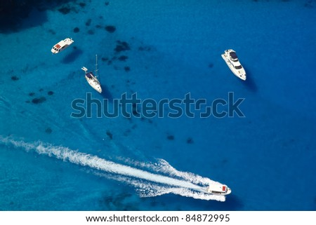 Top view on boats in azure water - stock photo