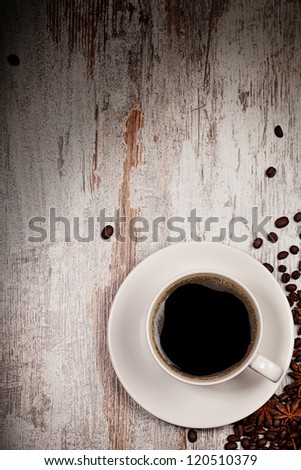 top view on cup of coffee over grunge wooden bacgkround - stock photo