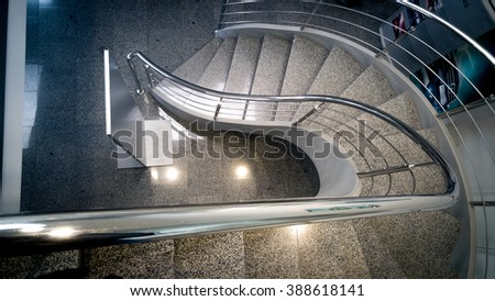 Top view on curved stone staircase at office building - stock photo