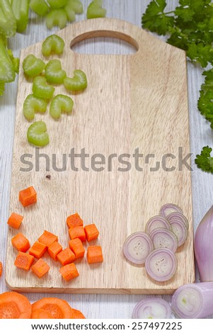 Top view on cutting board with fresh vegetables - stock photo