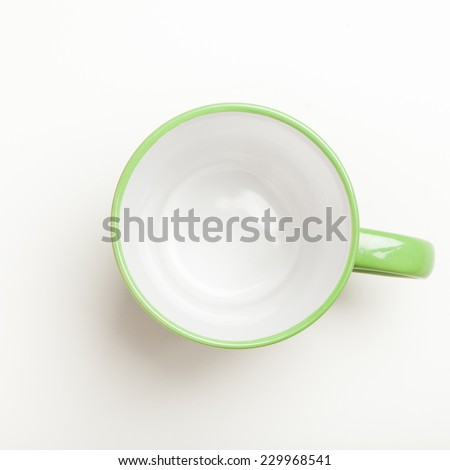 Top view on empty green coffee or tea mug or cup. Studio shot from above on white background. - stock photo
