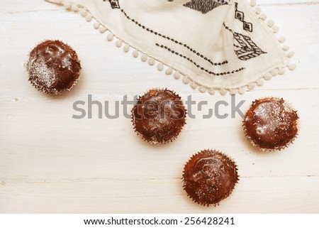 Top view on fresh baked chocolate muffins on the table - stock photo