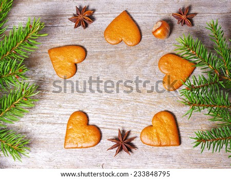 Top View on gingerbread heats on old wooden table. Christmas background - stock photo